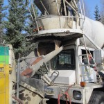 mixing truck pours cement into concrete pump