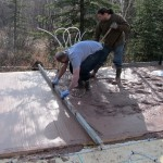 screeding, or leveling, the slab