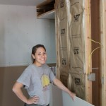 Student worker Taak hanging Sheetrock