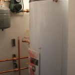 120-gallon thermal storage tank in the NE home stores heat from solar thermal collectors and the Toyo.