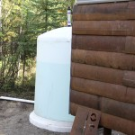 Each home has a 1,000 gallon water tank. Two are located outside and two inside. The outside ones will be insulated with spray foam.